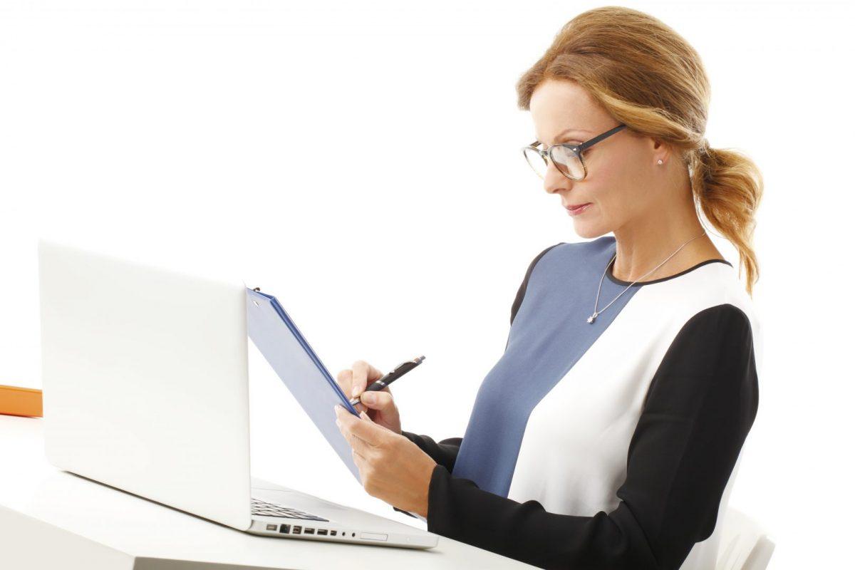 woman taking computer repair notes