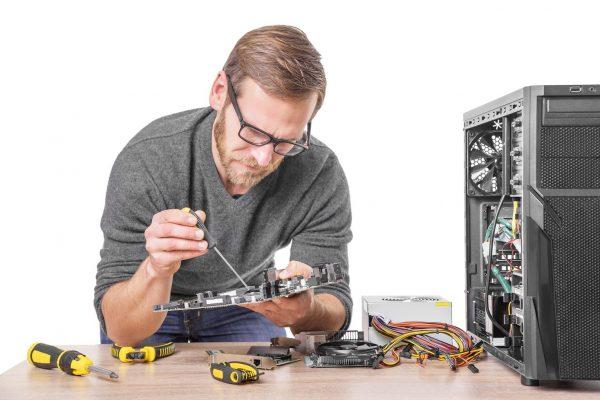 Technician performing computer repair