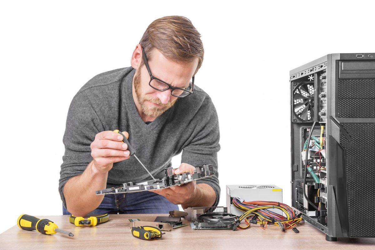 Technician Repairing PC