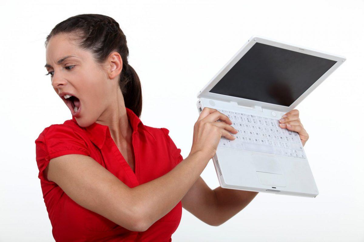 woman throwing computer to break it